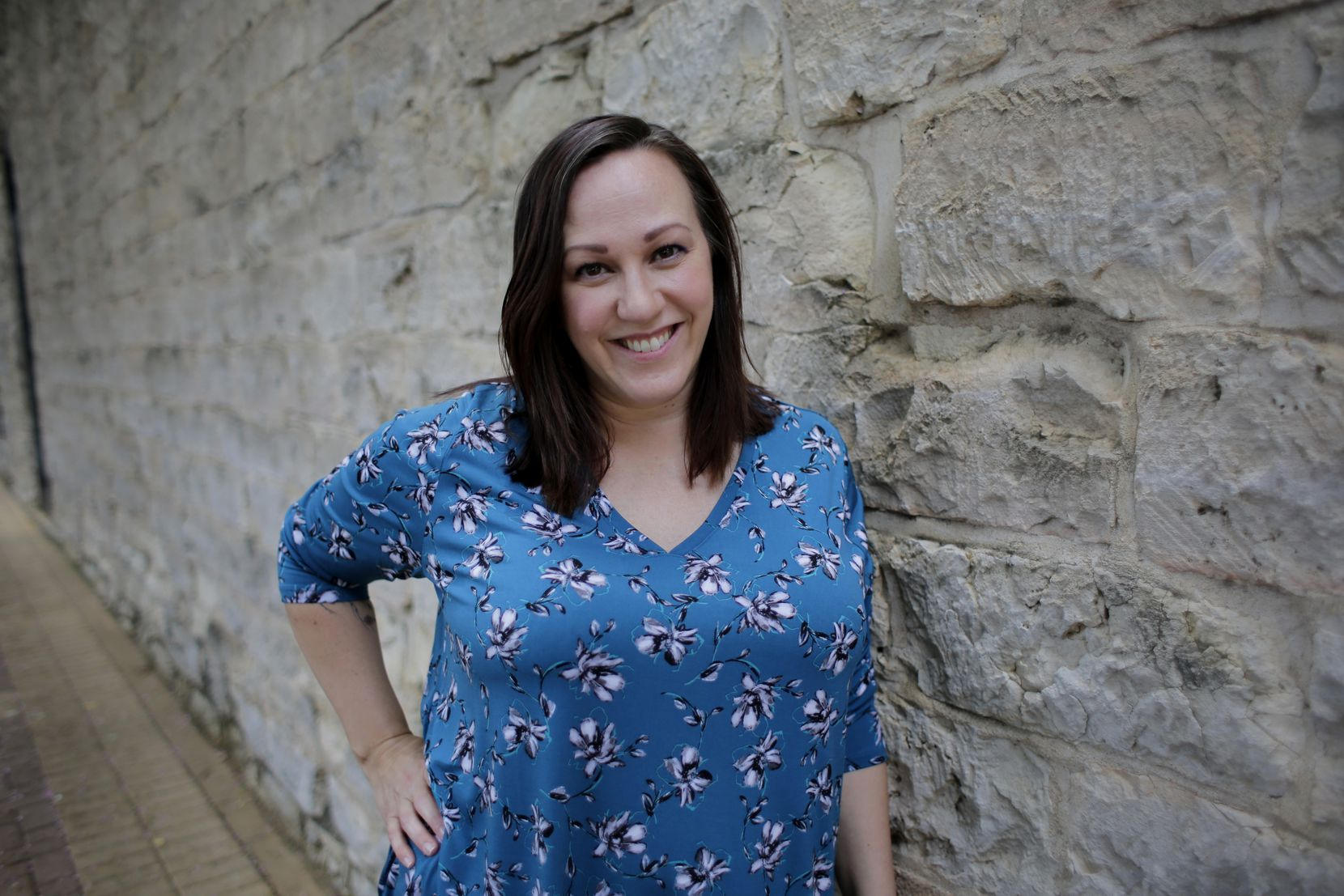 FILE - In this July 1, 2019, file photo, Air Force veteran MJ Hegar poses for a photo in Round Rock, Texas. Hegar is the choice of Senate Democrats' campaign arm to take on Republican incumbent John Cornyn in 2020, picking up a key endorsement Monday, Dec. 16, 2019, in a crowded and widely unknown field of challengers. (AP Photo/Eric Gay, File)
