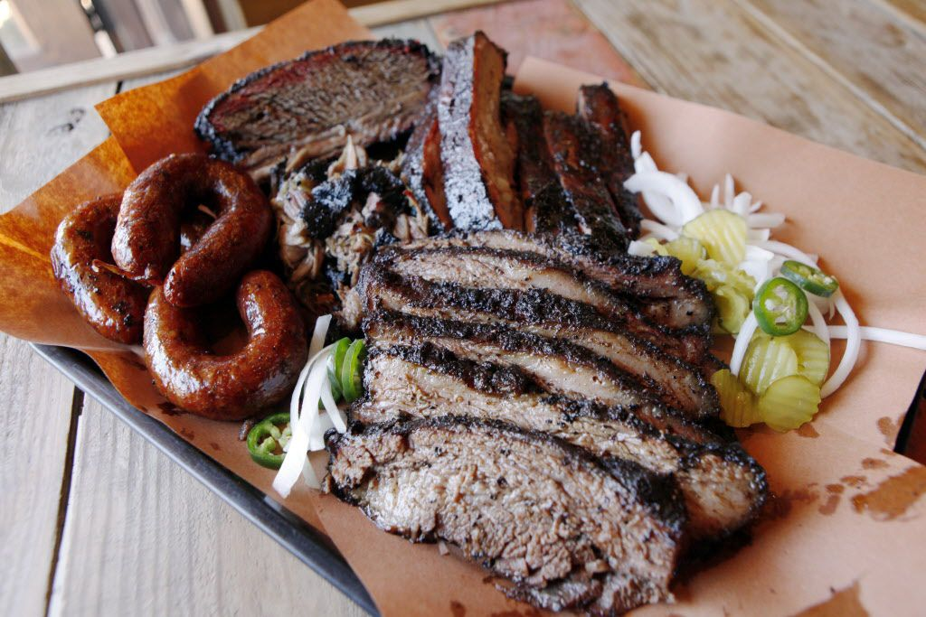 The family style platter with beef rib, brisket, pork ribs, pulled pork and sausage from the Pecan Lodge restaurant in Deep Ellum, on Wednesday, Sept. 24, 2014 in Dallas. Ben Torres/Special Contributor 10032014xGUIDE 12262014xGUIDE