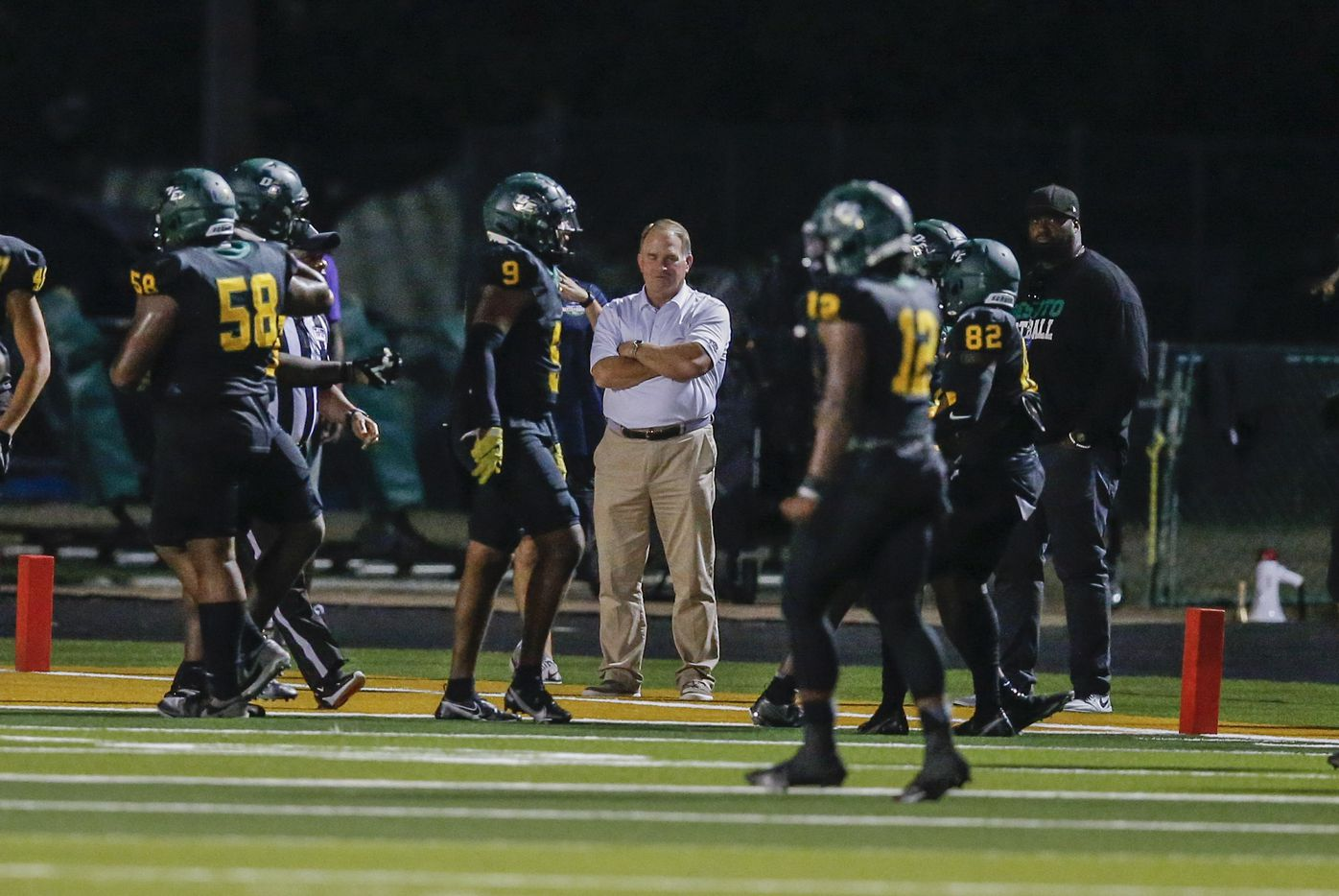 TCU head football coach Gary Patterson, center, looks on from the sidelines during the first half of a high school football game between Duncanville and DeSoto at DeSoto High School, Friday, September 17, 2021. (Brandon Wade/Special Contributor)