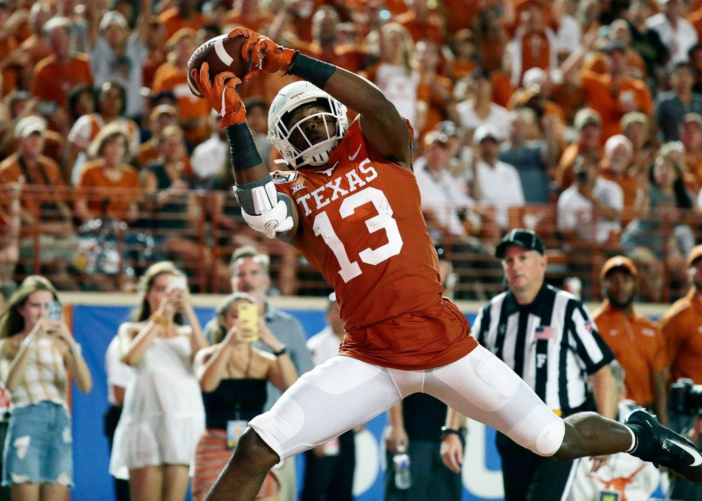 Texas wide receiver Brennan Eagles (13) pulls in a pass for a touchdown against Louisiana Tech during the second half of an NCAA college football game, Saturday, Aug. 31, 2019, in Austin, Texas. (AP Photo/Eric Gay)