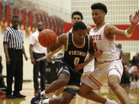 Arlington Lamar's Le'Andre Roberts (0) drives to the basket as he is defended by South Grand Prairie's Khaden Bennett (4) during SGP's 66-57 win Tuesday. (Vernon Bryant/The Dallas Morning News)