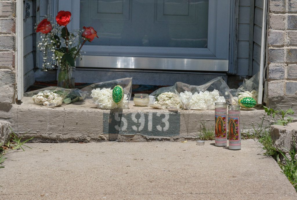 A small memorial is starting to form on the front step of 5913 Mimosa Lane in Rowlett, Texas Monday, May 7, 2018. Policarpo Gonzalez-Flores, 40, shot his 11-year-old son,  James Gonzalez, before killing himself on Saturday, May 5, 2018, according to authorities. Gonzalez-Flores' wife, Stephanie Gonzalez, had been on the phone with her husband before she called 911. The two had been arguing about marital issues earlier that night. (Ron Baselice/The Dallas Morning News)