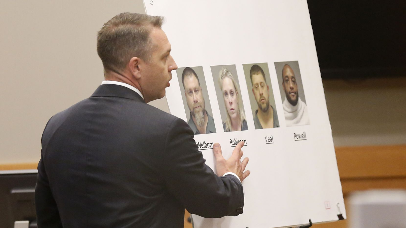 Ronnie Welborn, one of four people charged in a Collin County murder-for-hire plot, pled guilty to capital murder in the case and was sentenced this week to life in prison without parole. In this photo, Dewey Mitchell, a Collin County prosecutor, points to photos of the four alleged conspirators during the closing arguments of the capital murder trial of Robert Veal, another alleged conspirator, on Thursday, Jan. 30, 2020. (Vernon Bryant/The Dallas Morning News)