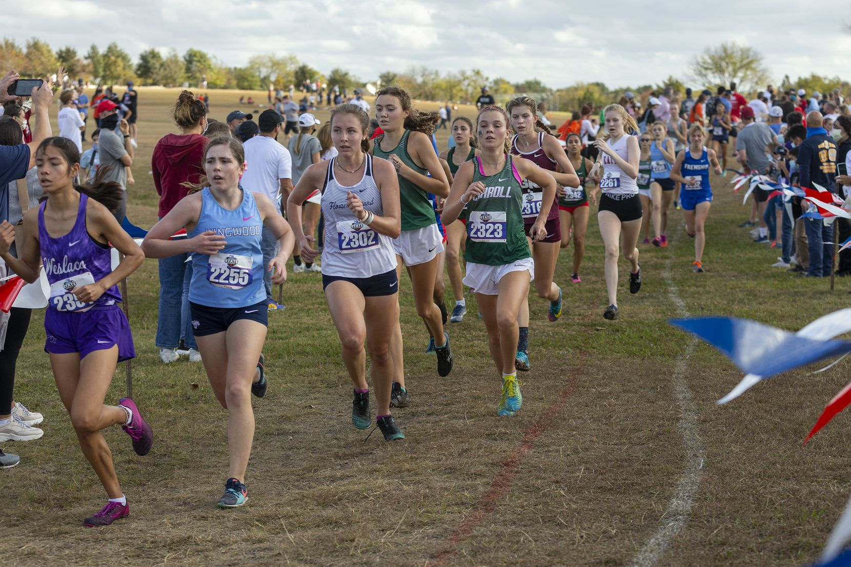 Flower Mound's Hannah McLaughlin (2302) and Southlake Carroll's Ava Bushaw (2323)compete in the girls UIL Class 6A state cross country meet in Round Rock, Tuesday, Nov., 24, 2020. (Stephen Spillman/Special Contributor)