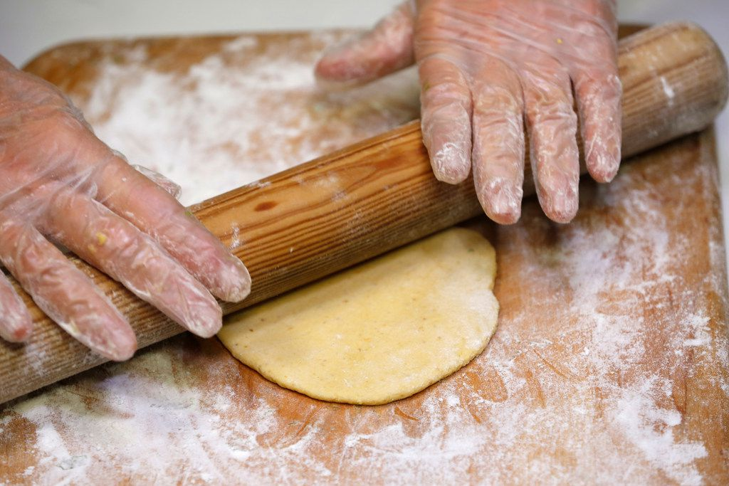Dotty Griffith rolls out dough for tortillas