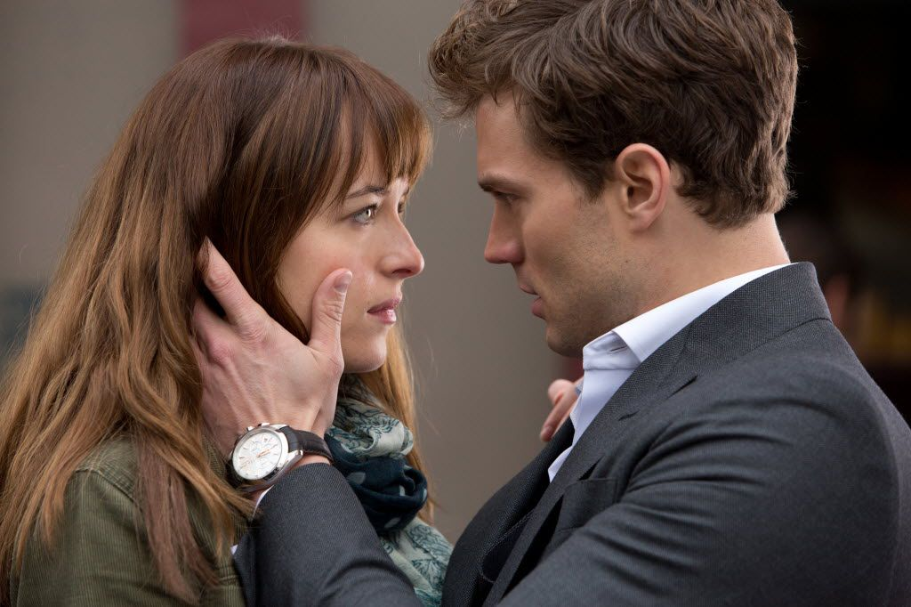 "In this image released by Universal Pictures and Focus Features, Dakota Johnson, left, and Jamie Dornan appear in a scene from the film, ""Fifty Shades of Grey."""