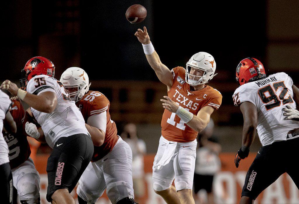 Texas quarterback Sam Ehlinger (11) throws the ball against Oklahoma State on Saturday, Sept. 21, 2019, at Royal Texas Memorial Stadium in Austin, Texas. The host Longhorns won, 36-30. (Nick Wagner/Austin American-Statesman/TNS)