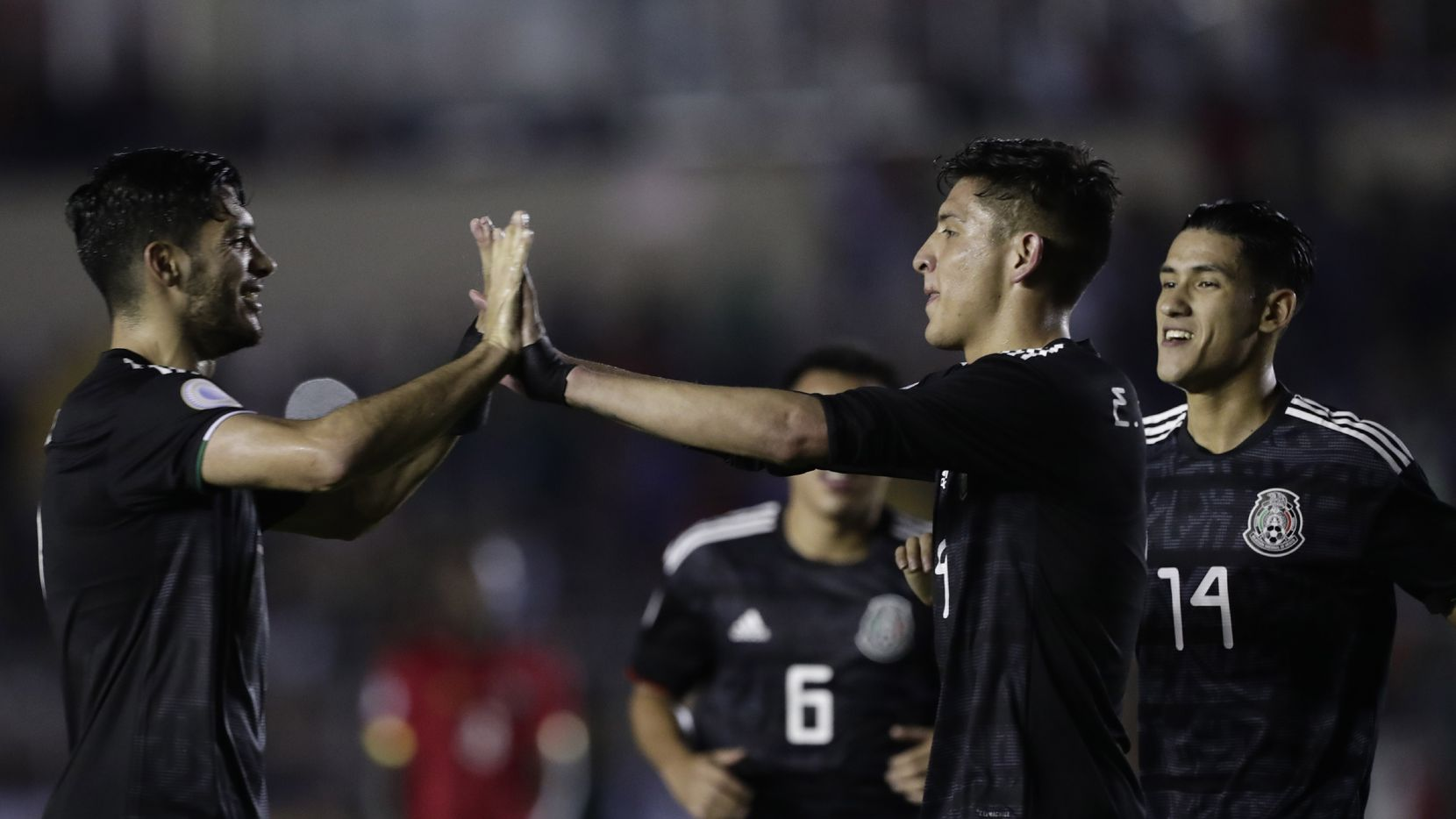 Mexico's Edson Alvarez, second from right, celebrates scoring his side's 2nd goal against Panama with teammates Raul Jimenez, left, and Carlos Antuna during a CONCACAF Nations League soccer match at the Rommel Fernandez stadium in Panama City, Friday, Nov. 15, 2019. (AP Photo/Arnulfo Franco)