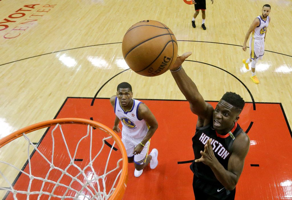 Houston Rockets center Clint Capela, right, scores past Golden State Warriors forward Kevon Looney in the first half during Game 5 of the NBA Western Conference Finals, Thursday, May 24, 2018, in Houston. (AP Photo/David J. Phillip)