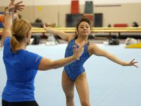 Coach Kim Zmeskal gives instruction to Emma Malabuyo after a floor routine during practice at Texas Dreams Gymnastics on Tuesday, June 15, 2021 in Coppell, Texas. Malabuyo is preparing to compete in the U.S. Olympic Gymnastics Trials next week.