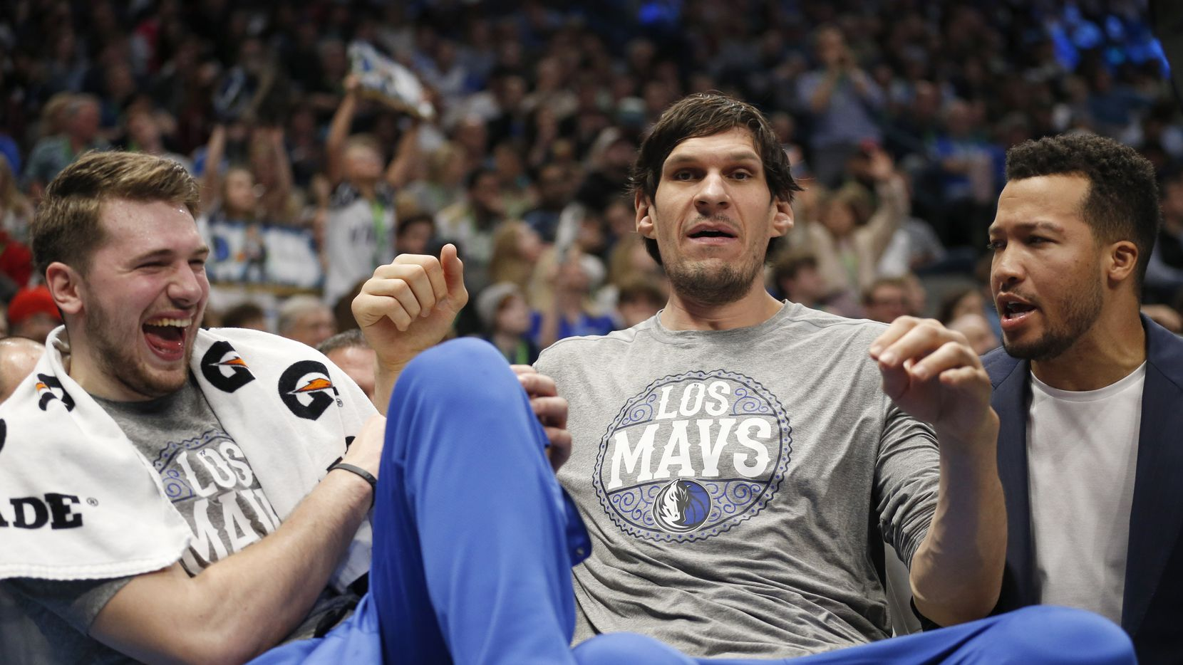 Dallas Mavericks center Boban Marjanovic (51) separates Dallas Mavericks guard Luka Doncic (77) and Dallas Mavericks guard Jalen Brunson (13) in a game against the Memphis Grizzlies during the first half of play at American Airlines Center in Dallas on Friday, March 6, 2020.