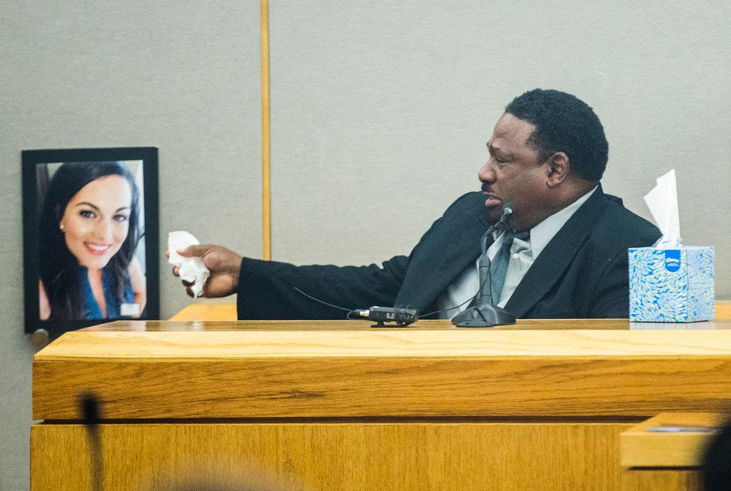 Kim Love, father of Kristopher Love, points to a photo of Kendra Hatcher and apologizes to her family during the punishment phase of a capital murder trial for Kristopher Love on Tuesday, October 30, 2018 at the Frank Crowley Courts Building in Dallas. Love was convicted in the 2015 murder of pediatric dentist Kendra Hatcher. He could face the death penalty. (Ashley Landis/The Dallas Morning News)
