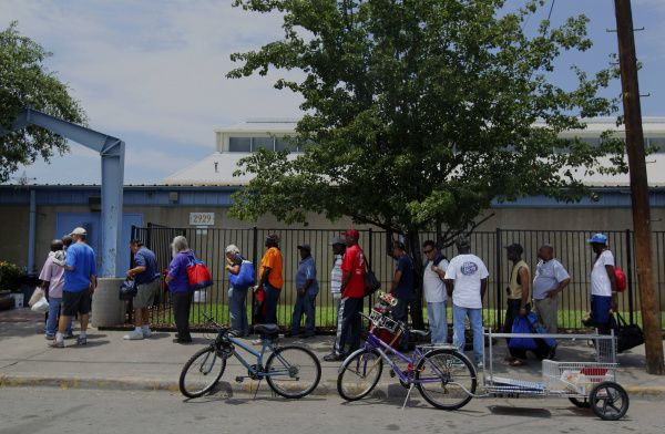 Men lined up Tuesday afternoon outside the Austin Street Shelter, where services are provided to the homeless.