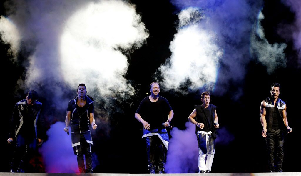 (From l to r) New Kids on the Block members Jonathan Knight, Jordan Knight, Donnie Wahlberg, Joey McIntyre, and Danny Wood during a performance at American Airlines Center in Dallas, on Thursday, May 14, 2015.