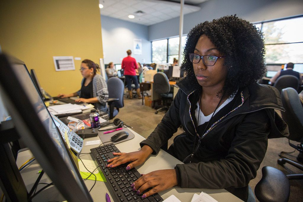 """Candace Mosely, who wants to be an """"intake specialist"""" at the Texas Abuse Hotline, takes calls during a hands-on training session at the Texas Department of Family and Protective Services' Statewide Intake Division in Austin. (Thao Nguyen/Special Contributor)"""
