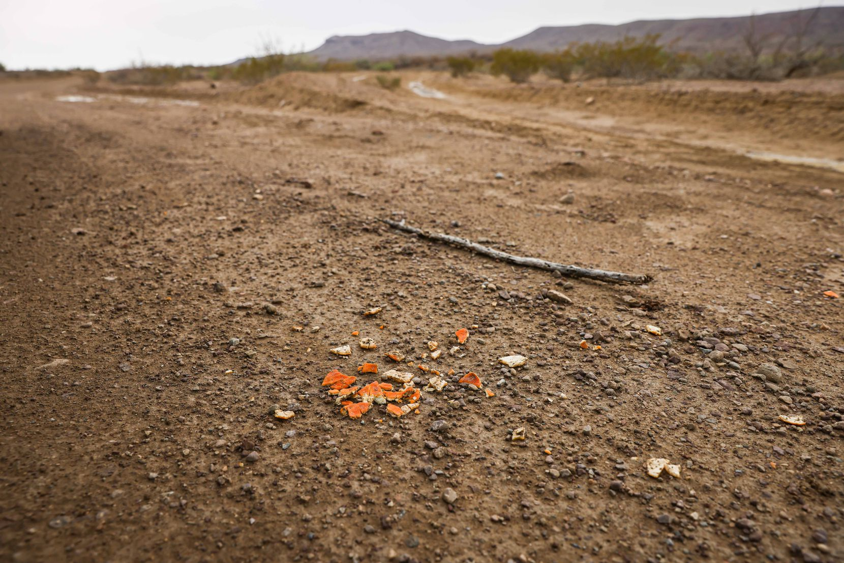 Orange peels lie on the ground in Jeff Davis County. Culberson County Sheriff Oscar Carrillo said he received a distress call from a rancher using a satellite phone on June 21. The rancher had found two migrants in the desert: Raul, 35, and his son Christian, 15.
