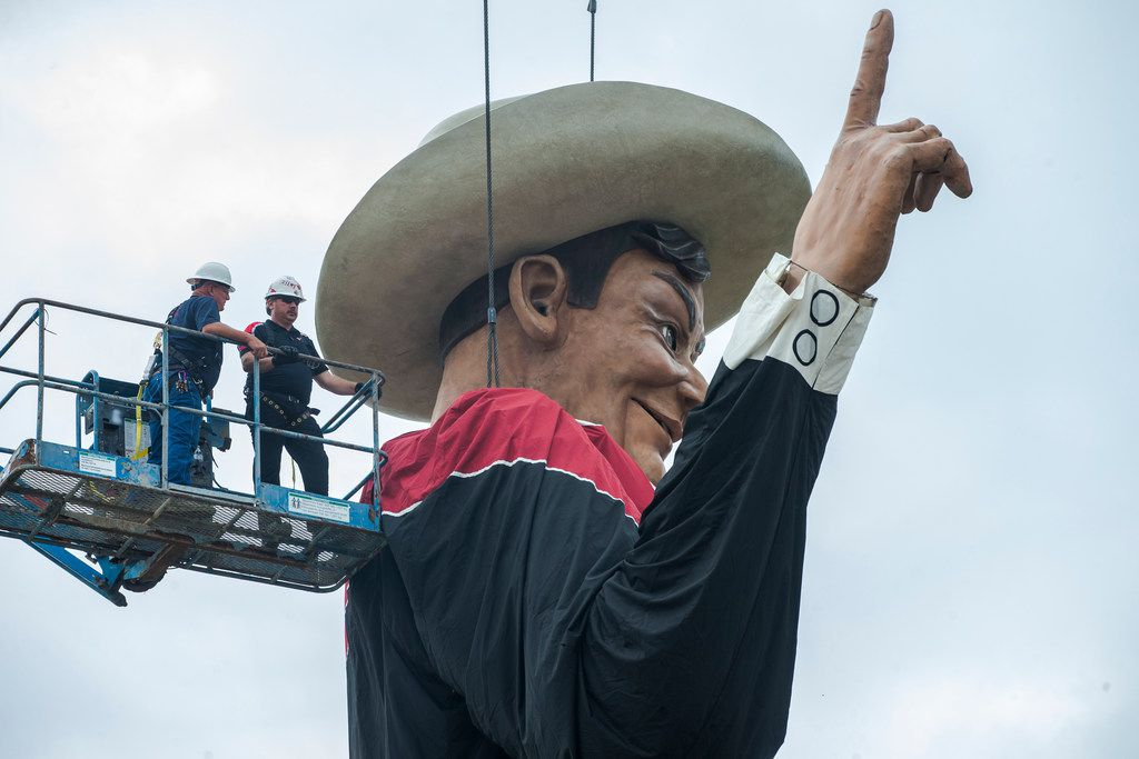 Workers help Big Tex take his spot on Friday, September 21, 2018 at Fair Park in Dallas. Big Tex haas been the official State Fair of Texas' icon for the past 66 years.