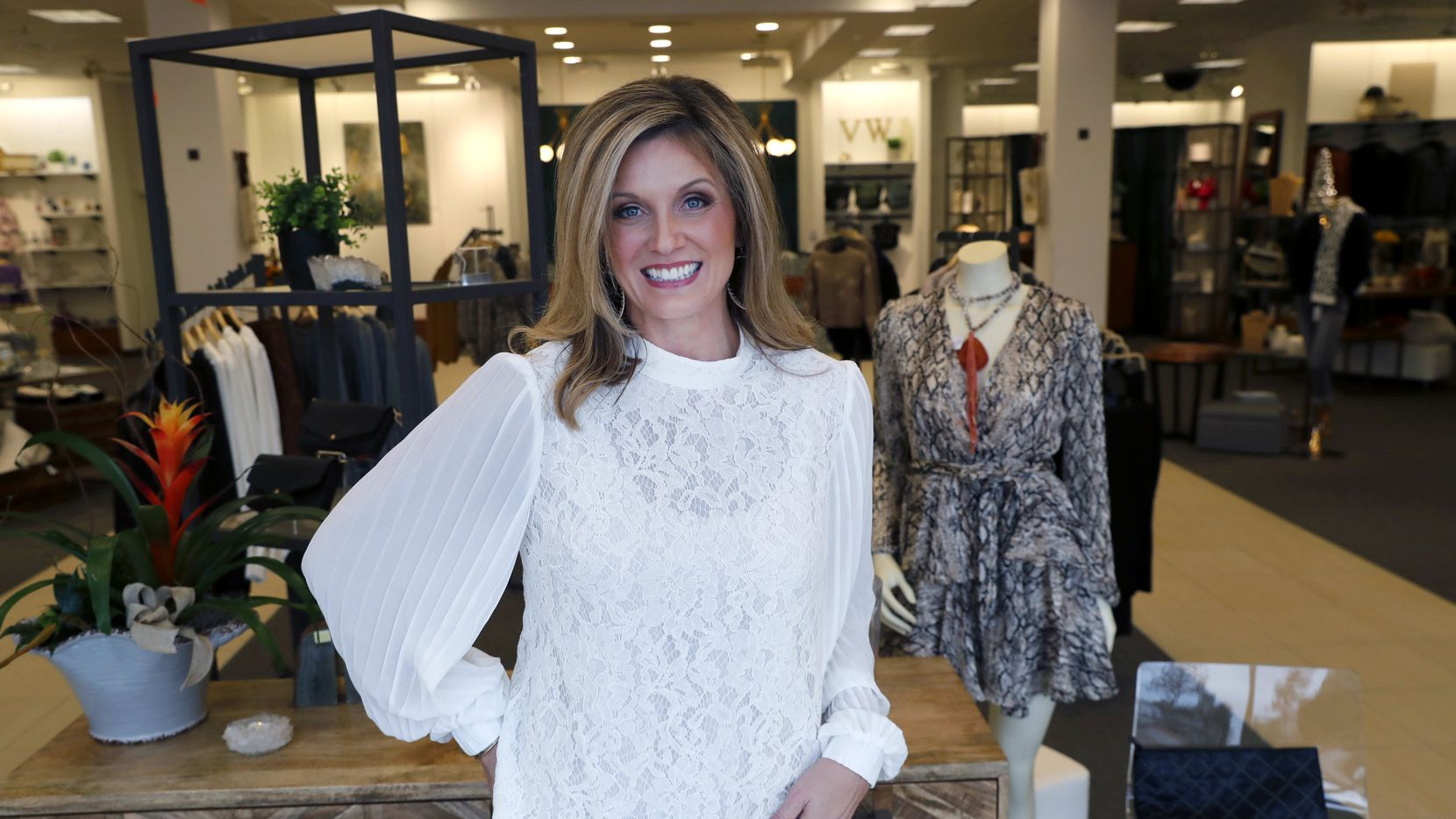 In Nov. 26 photo, Amy Witt, owner of the Velvet Window, posses for a photo at her retail store in Dallas. Heading into the holiday shopping season, Witt opened a physical store to attract more shoppers than just those who have been her online customers.
