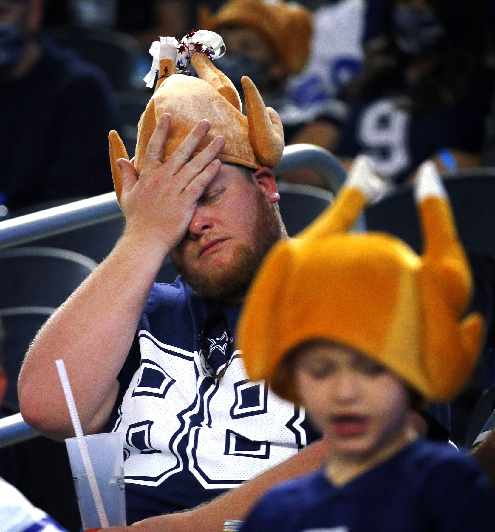 Dallas Cowboys fan Alex Chambers reacts to a missed played Cowboys drive against the Washington Football Team in the  quarter at AT&T Stadium in Arlington, Thursday, November 26, 2020. (Tom Fox/The Dallas Morning News)