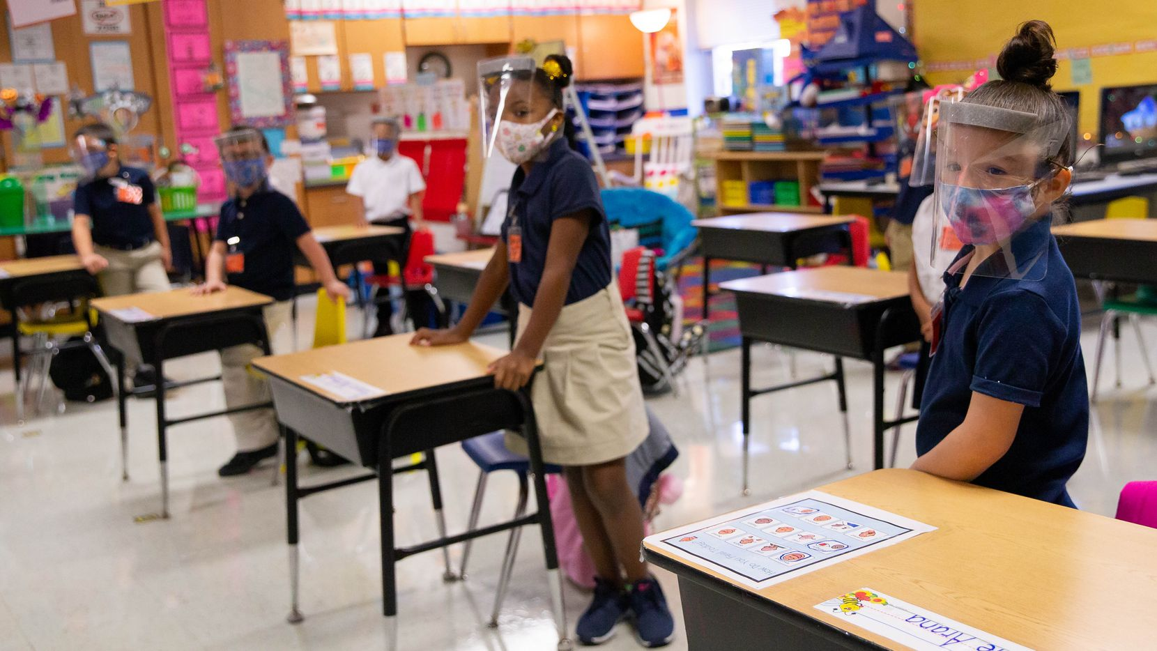 Students in Jerry R. Junkins Elementary teacher Christine Ricci's classroom in Carrollton on Oct. 5, 2020, when students from all grade levels in the district were allowed to return to in-person instruction. (Juan Figueroa/ The Dallas Morning News)