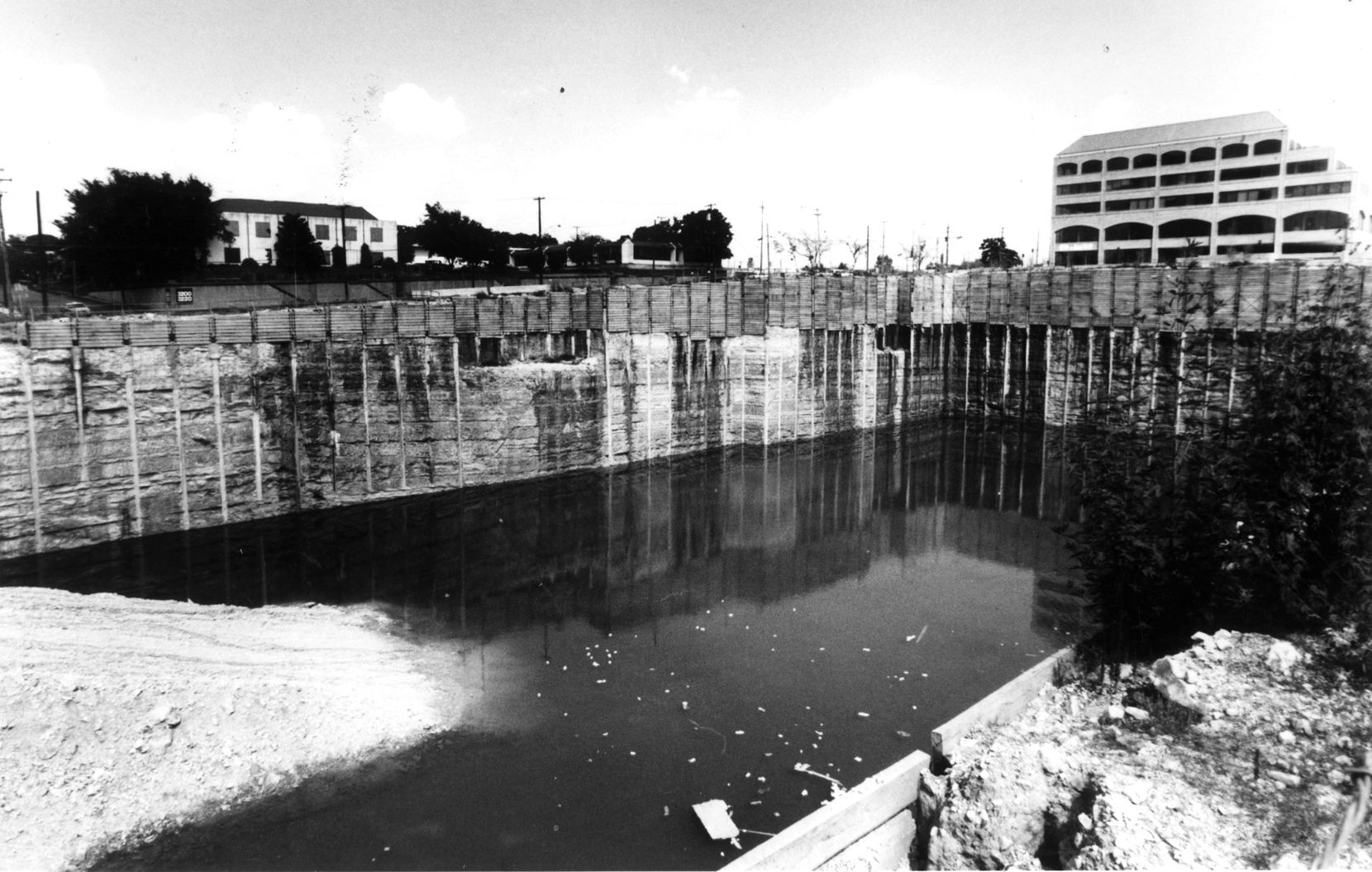 A 90-foot-deep hole filled with water at Cole and Lemmon in Uptown was a symbol of the real estate bust in the 1980s.