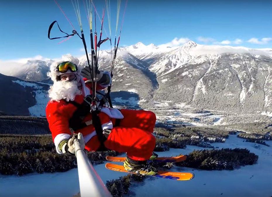 Santa takes flight on Rollercoaster Run, paragliding down into British Columbia's Panorama Mountain Resort on Christmas morning.