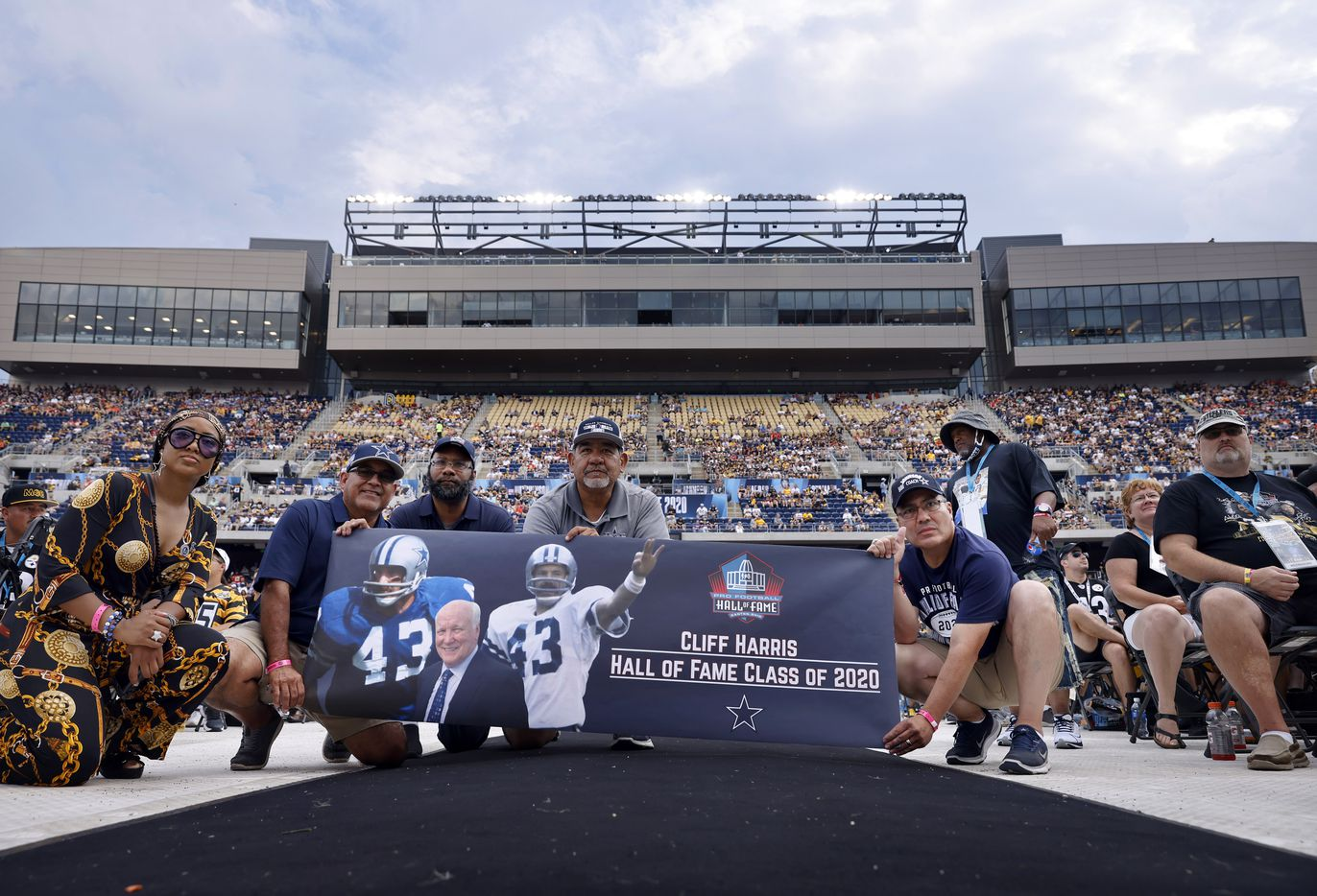 Dallas Cowboys fans display a banner of Pro Football Hall of Fame inductee Cliff Harris of the Dallas Cowboys as he spoke during the Centennial Class of 2020 enshrinement ceremony at Tom Benson Hall of Fame Stadium in Canton, Ohio, Saturday, August 7, 2021. (Tom Fox/The Dallas Morning News)