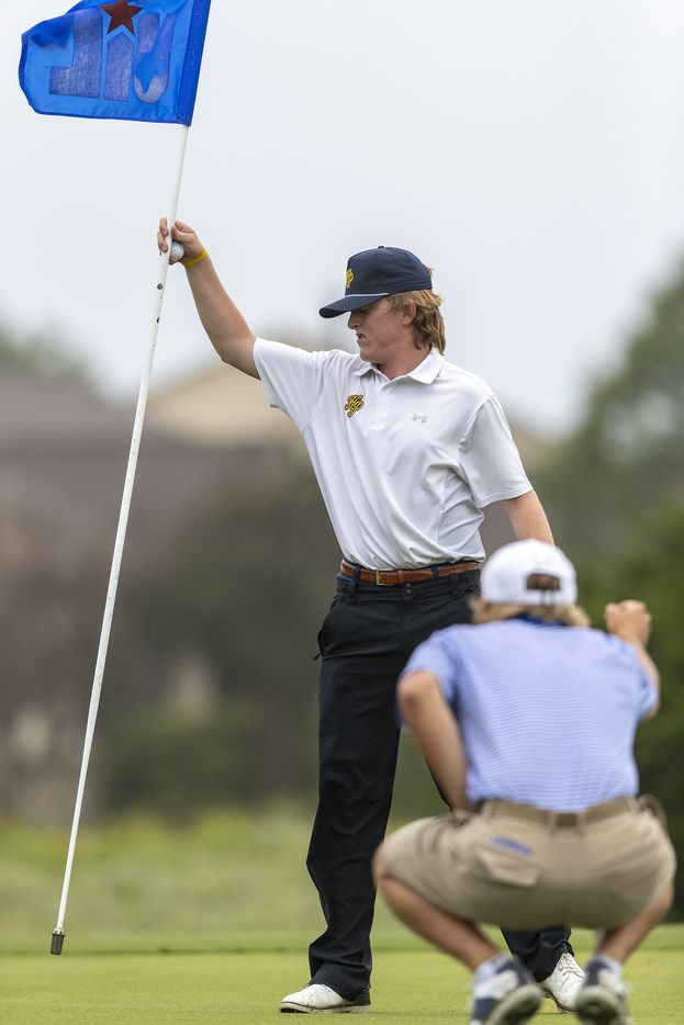 Highland ParkÕs Thompson Huthnance removes the pin on the 11th green during round 1 of the UIL Class 5A boys golf tournament in Georgetown, Monday, May 17, 2021. (Stephen Spillman/Special Contributor)
