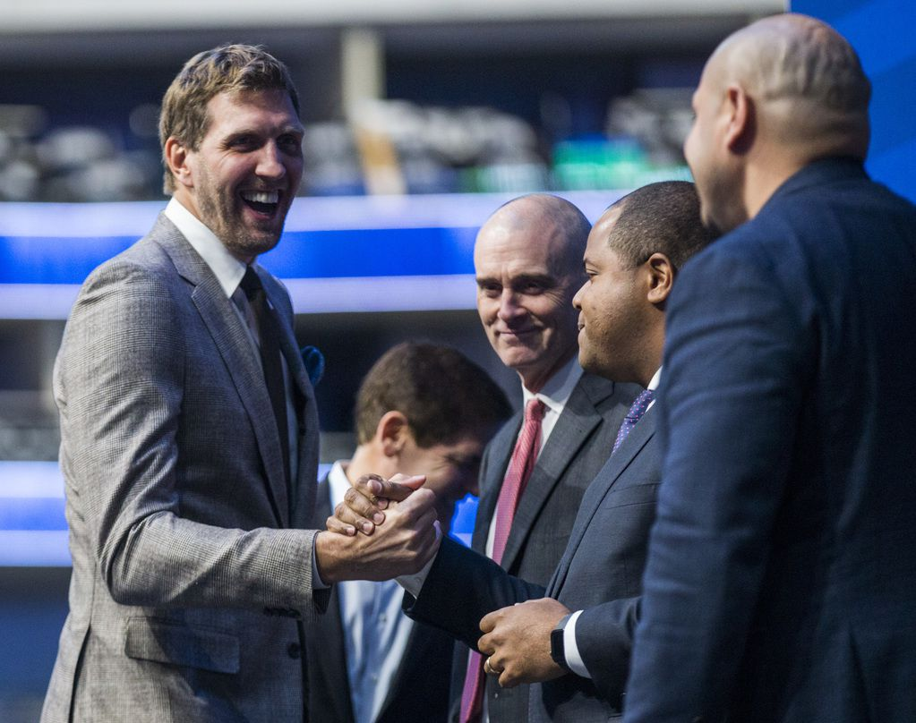 Retired Dallas Mavericks player Dirk Nowitzki (left) shakes hands with Dallas Mayor Eric Johnson (second from right) during a street naming ceremony on Wednesday, October 30, 2019 at American Airlines Center in Dallas. The street in front of the arena was renamed Nowitzki Way. Mavs Owner Mark Cuban, Mavs Head Coach Rick Carlisle and Dallas Mayor Pro Tem Adam Medrano are also pictured.