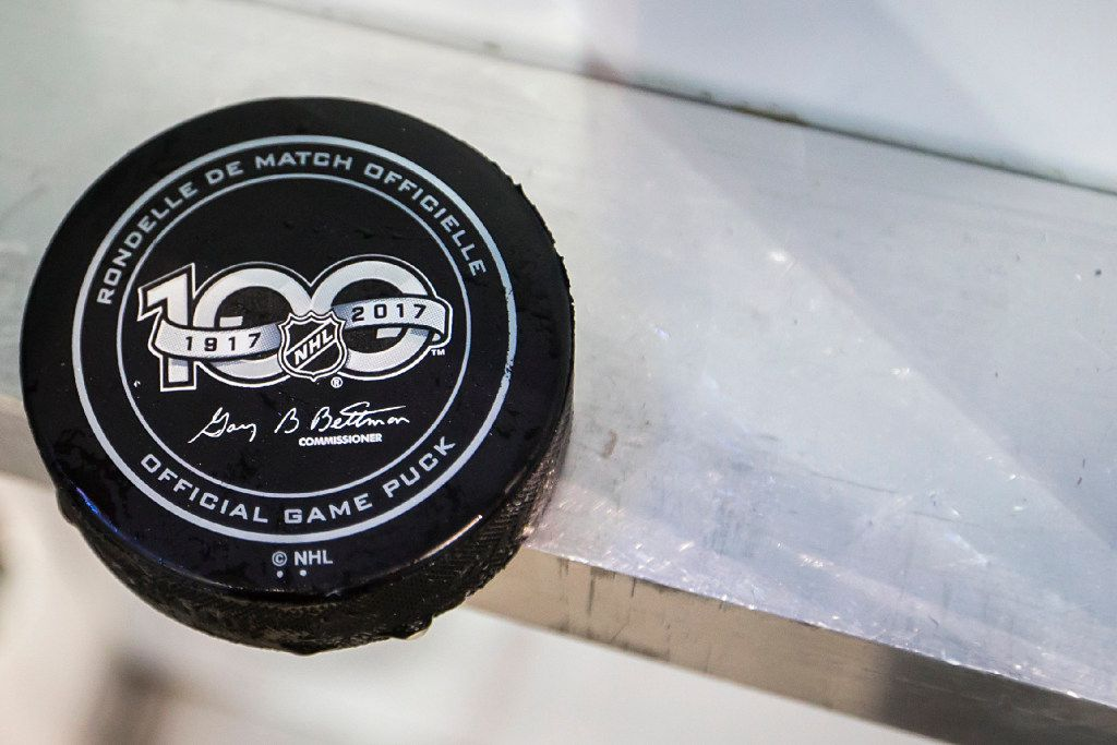 A puck rests behind the boards near the bench during the third period of an NHL hockey game between the Dallas Stars and the Carolina Hurricanes at the American Airlines Center on Saturday, Feb. 11, 2017, in Dallas. (Smiley N. Pool/The Dallas Morning News)
