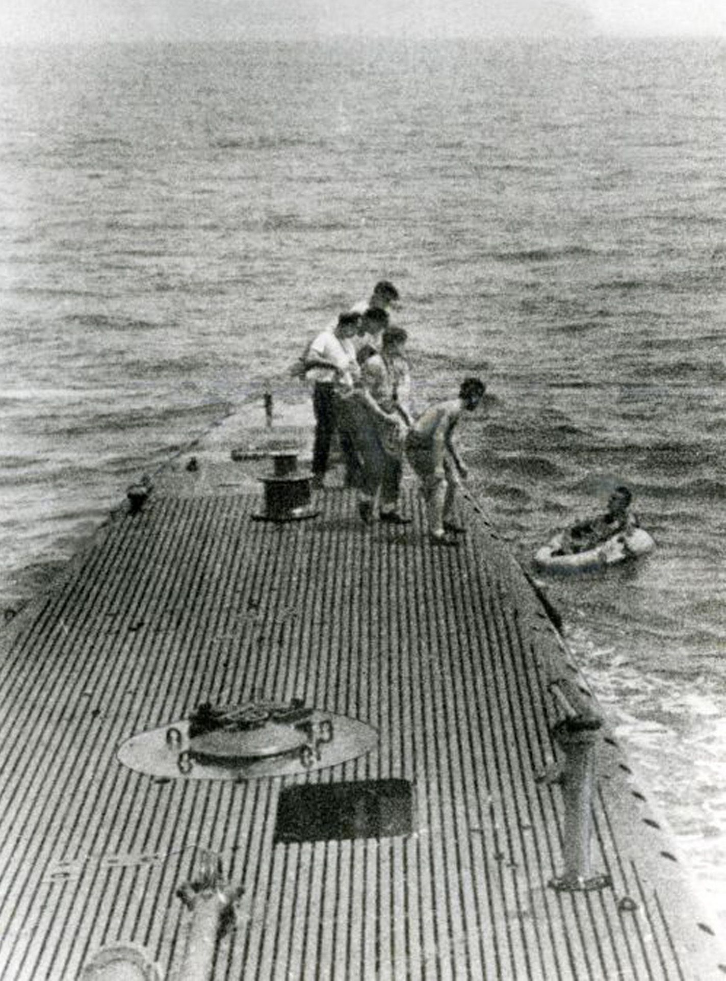 1944: Navy pilot George Bush (right) is pulled from the ocean by sailors onboard the Navy submarine USS Finback. After his plane was downed, he survived for hours in a small raft.