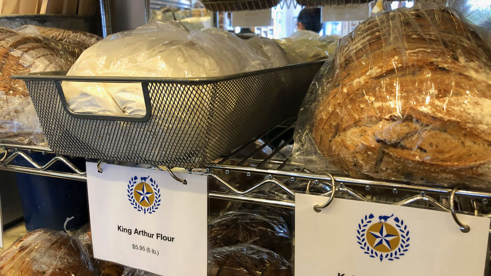 Empire Baking Co. is selling 5-pound sacks of all-purpose flour along with a more limited selection of breads at its Inwood Village retail location.