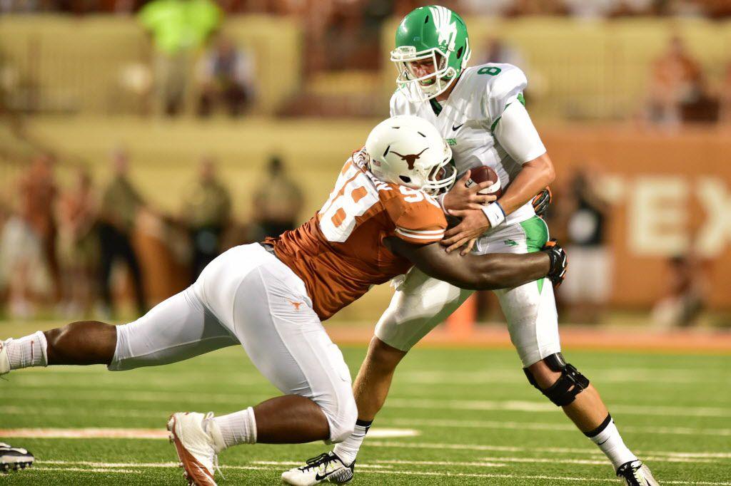 Texas defensive tackle Hassan Ridgeway (98) records one of his six sacks in 2014 against North Texas quarterback Josh Greer (8) . David Minton/DRC