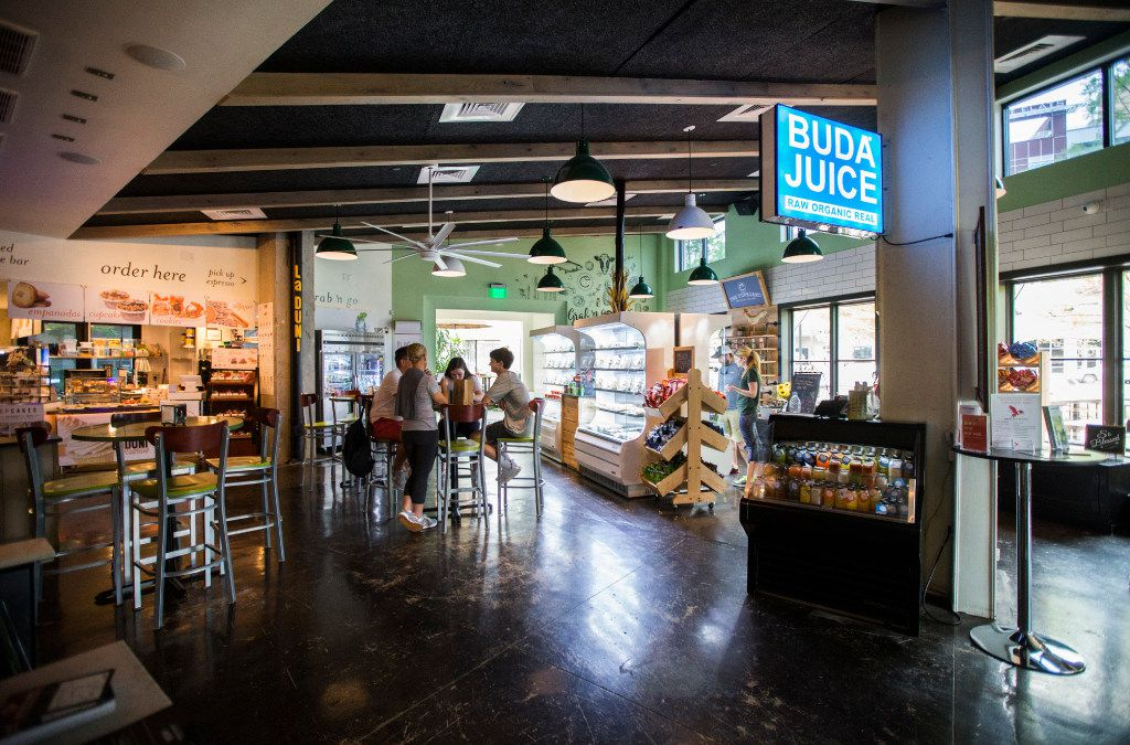 Customers eat at Uptown Urban Market on Saturday, April 15, 2017 on Cedar Springs Road in Dallas. The new food hall includes Fireside Pies, La Duni Baking & Coffee Studio, The Hot Counter, Bar Up, Buda Juice, The Cupboard Grab & Go, Ill Minster bar and Bicycle Hub Company