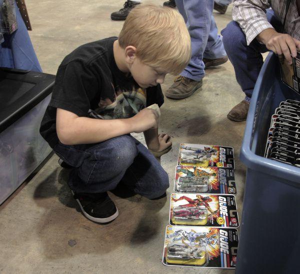 A boy looks at G.I. Joe collectibles.