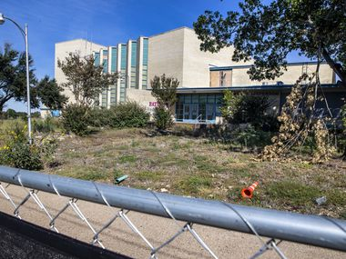 The dilapidated structure of Thomas Jefferson High School is photographed in Dallas on Friday, Oct. 16, 2020. The campus, along with Edward H. Cary Middle School, was destroyed by a tornado last October. The schools are still in desrepair, the latter having been demolished earlier this year, but the district says it's making some progress on renovating Thomas Jefferson High School. (Lynda M. González/The Dallas Morning News)