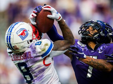 Southern Methodist Mustangs wide receiver Reggie Roberson Jr. (8) catches a pass with TCU Horned Frogs safety Trevon Moehrig (7) during the second quarter of a college football game between SMU and TCU on Saturday, September 21, 2019 at Amon G. Carter Stadium in Fort Worth.