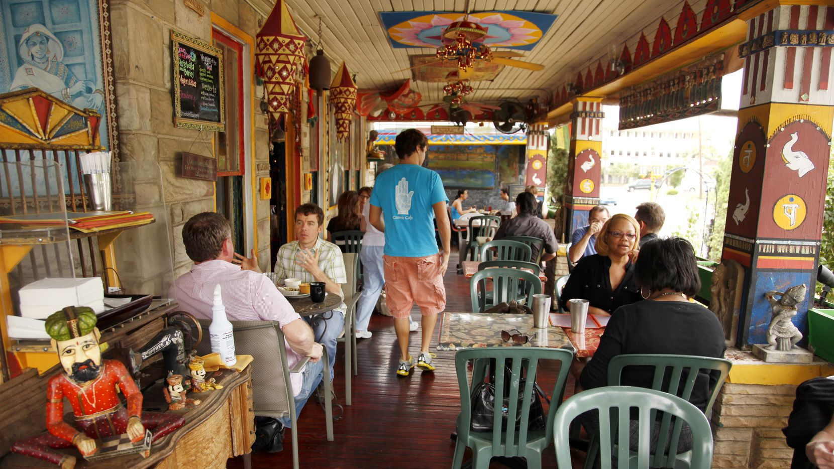 The lunch crowd on the patio at Cosmic Cafe, photographed April 26, 2012.