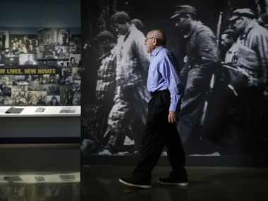 Holocaust survivor Max Glauben walks past a life-sized photo of prisoners on a death march from Dachau as he toured the new Dallas Holocaust and Human Rights Museum in downtown Dallas, Thursday, September 12, 2019.