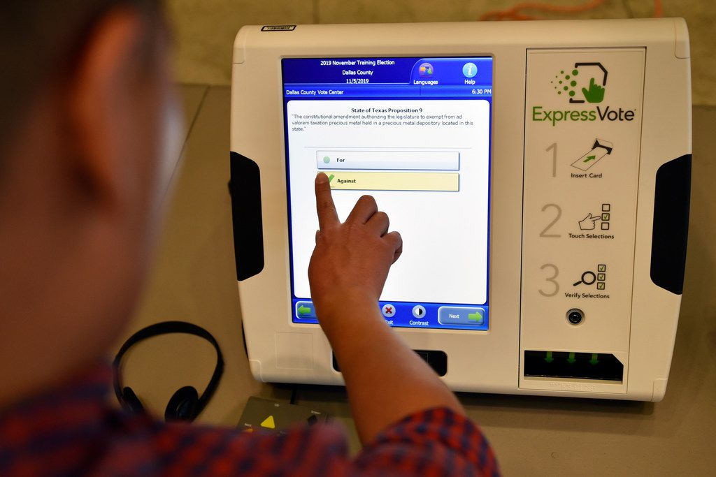 Omar Jimenez, 27, of Dallas, uses the new ExpressVote election machine during a demonstration of the new equipment to record votes, Sept. 25, 2019 at City Hall in Mesquite. Starting this Fall, Dallas voters will use the new equipment as well as visit voter centers to cast their ballot and not the precincts they're used to.