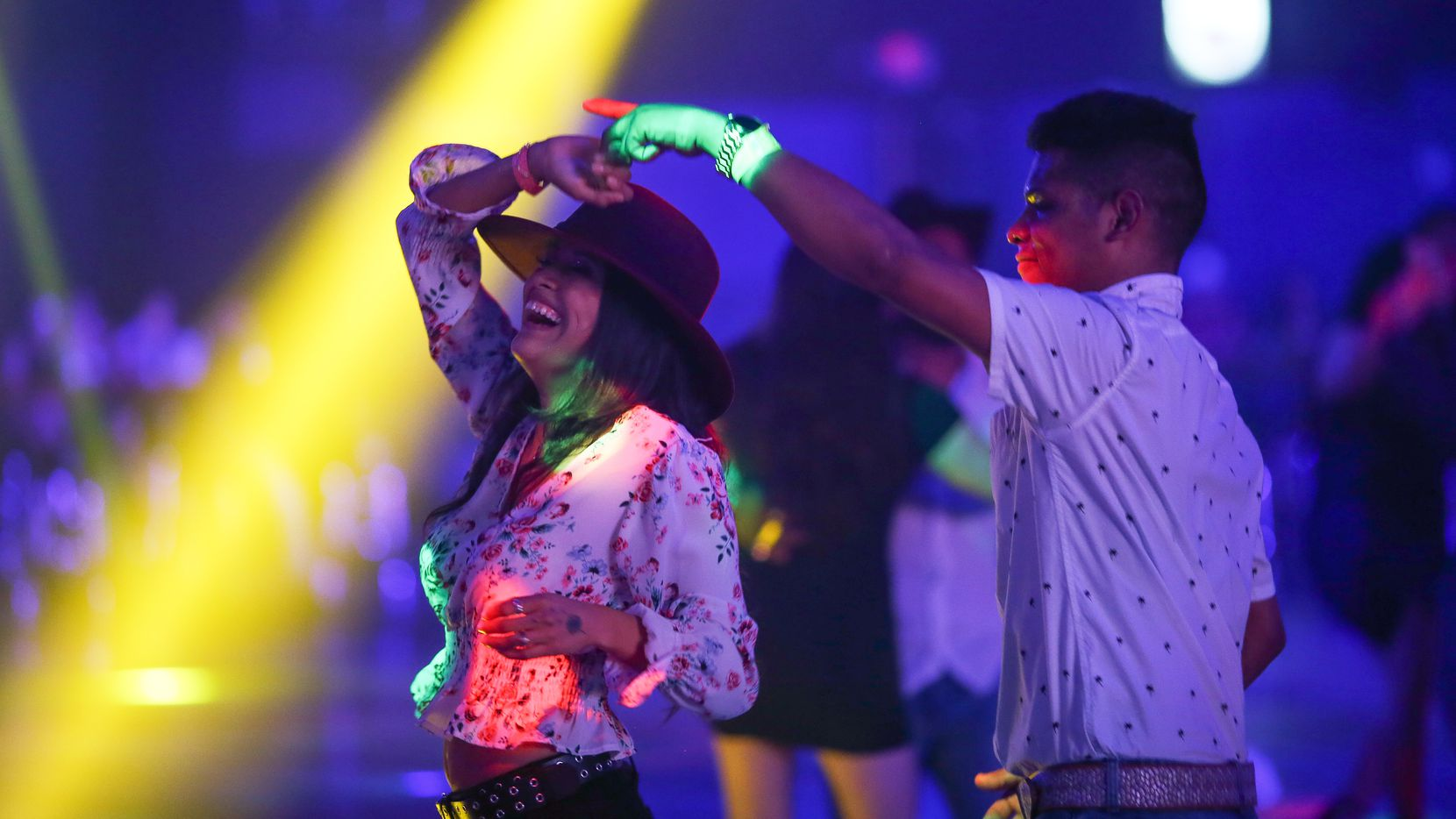 Young couple dance during a music concert at the Farwest Nightclub.. With the new executive order from Texas Governor Greg Abbott, which went into effect Wednesday, March 10, businesses can now reopen to 100% capacity while masks are no longer mandated by the state.