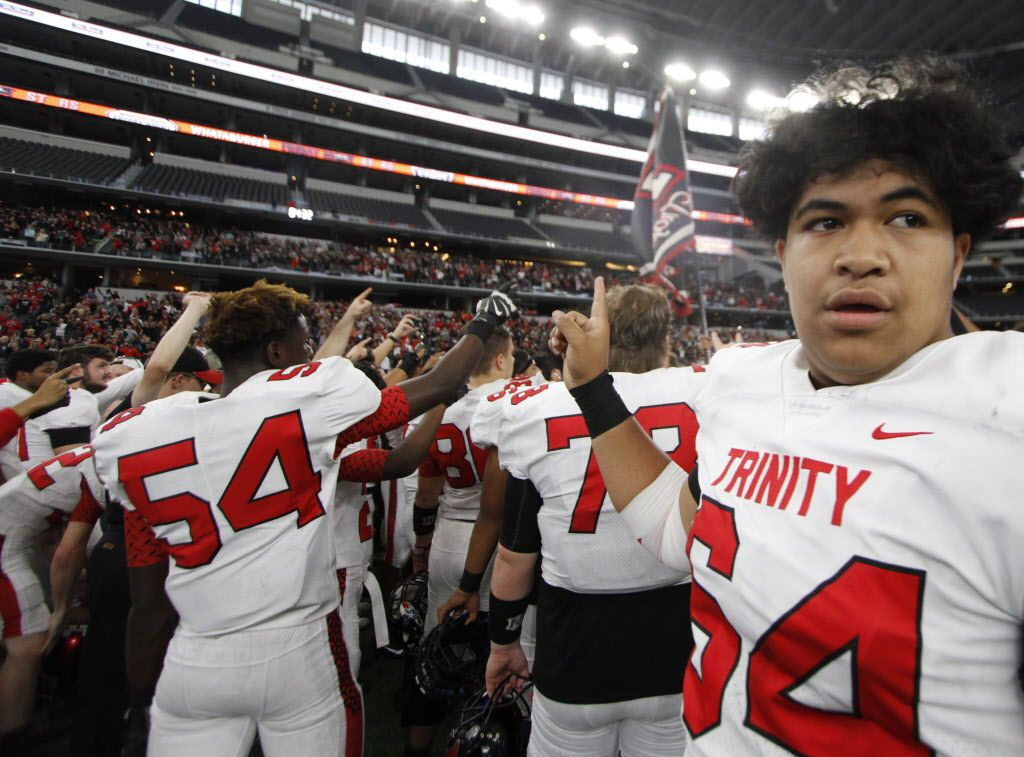 Euless Trinity offensive lineman David Toutai (64) takes in the moment during the playing of Trinity's school song following their 28-27 come-from-behind victory over Duncanville to advance in the playoffs. The two teams played in their Class 6A Division l area round UIL playoff football game at AT&T Stadium in Arlington on November 25, 2017. (Steve Hamm/Special Contributor)