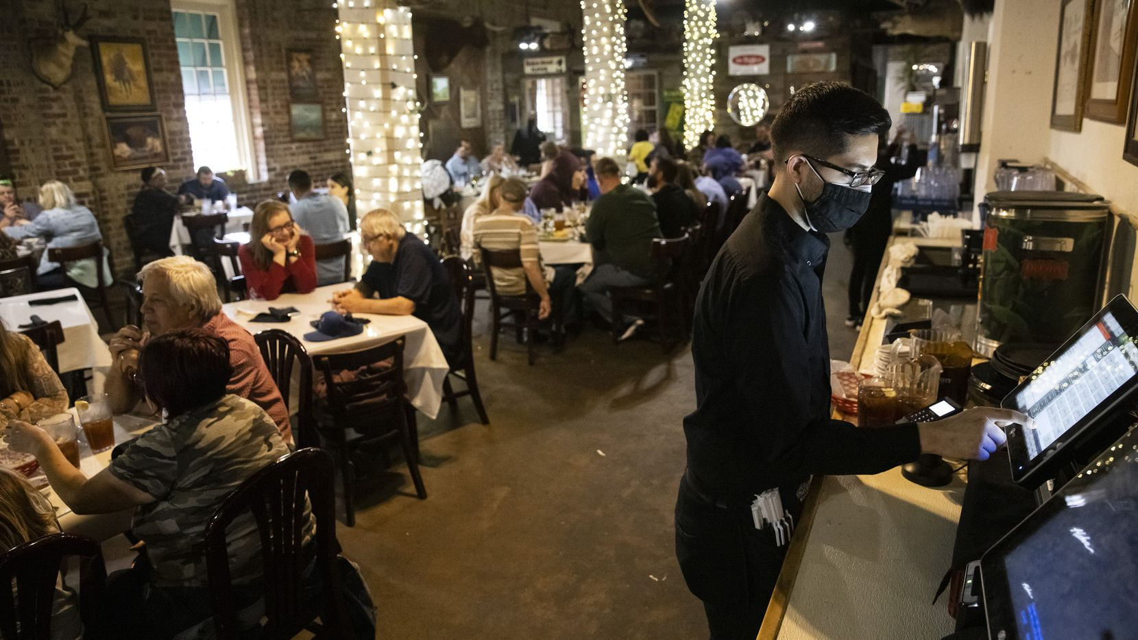 Customers visit Los Vaqueros in Fort Worth for an early dinner on Saturday, March 13, 2021. A year earlier, Los Vaqueros temporarily closed its dining room because of the impending coronavirus pandemic.