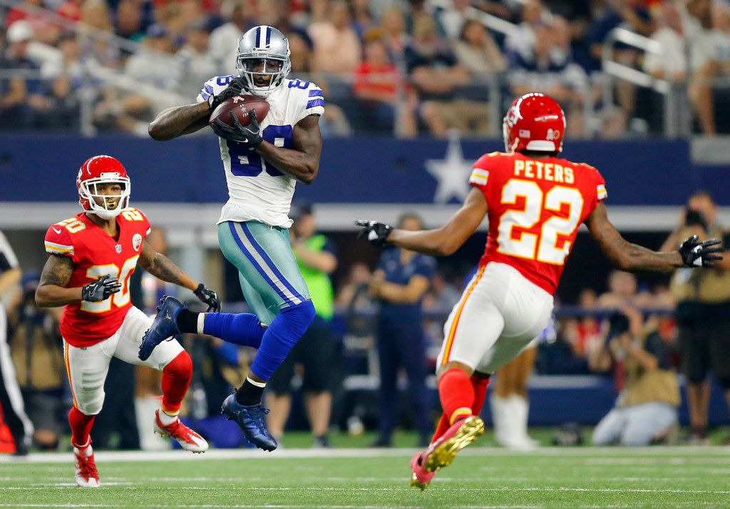 Dallas Cowboys wide receiver Dez Bryant (88) catches a pass across midfield before injuring his ankle when tackled by Kansas City Chiefs cornerback Steven Nelson (20) and defensive back Steven Terrell (30) during the fourth quarter at AT&T Stadium in Arlington, Texas, Sunday, November 5, 2017. (Tom Fox/The Dallas Morning News)