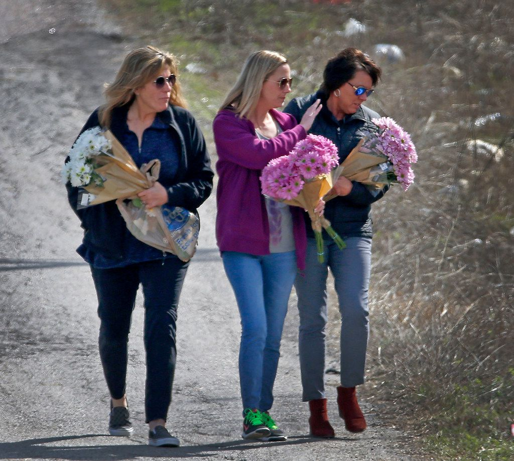 Jonni Hare (right), mother of Christina Morris, arrives with Rosie Aschenbrenner (left) and Danielle Cox where human remains were found in Anna on March 8, 2018.