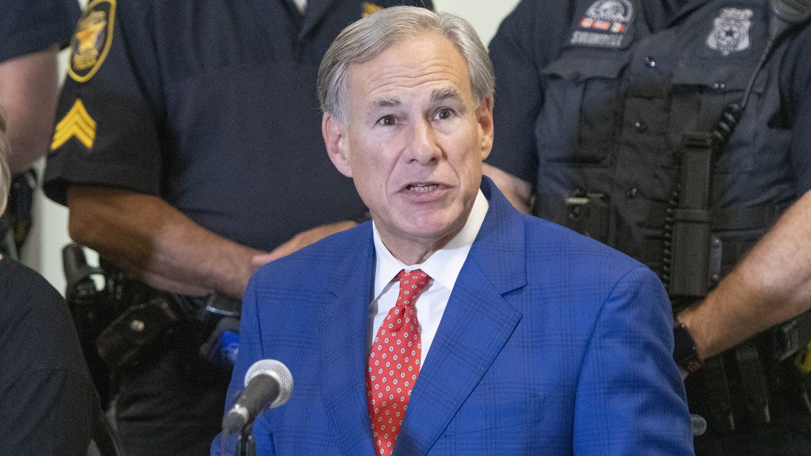 Texas Governor Greg Abbott, answers a question after signing HB9 into law during a press conference at the Fort Worth Police Officers Association headquarters on Friday September 17, 2021. (Robert W. Hart/Special Contributor)