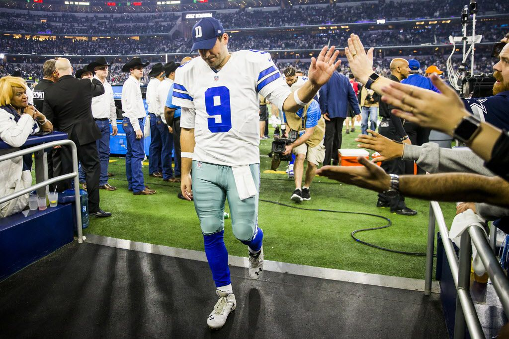 Dallas Cowboys quarterback Tony Romo high fives fans as walks off the field after the Green Bay Packers kicked a 51-yard game-winning field goal on the final play of an NFC divisional round playoff game at AT&T Stadium on Sunday, Jan. 15, 2017, in Arlington. (Smiley N. Pool/The Dallas Morning News)