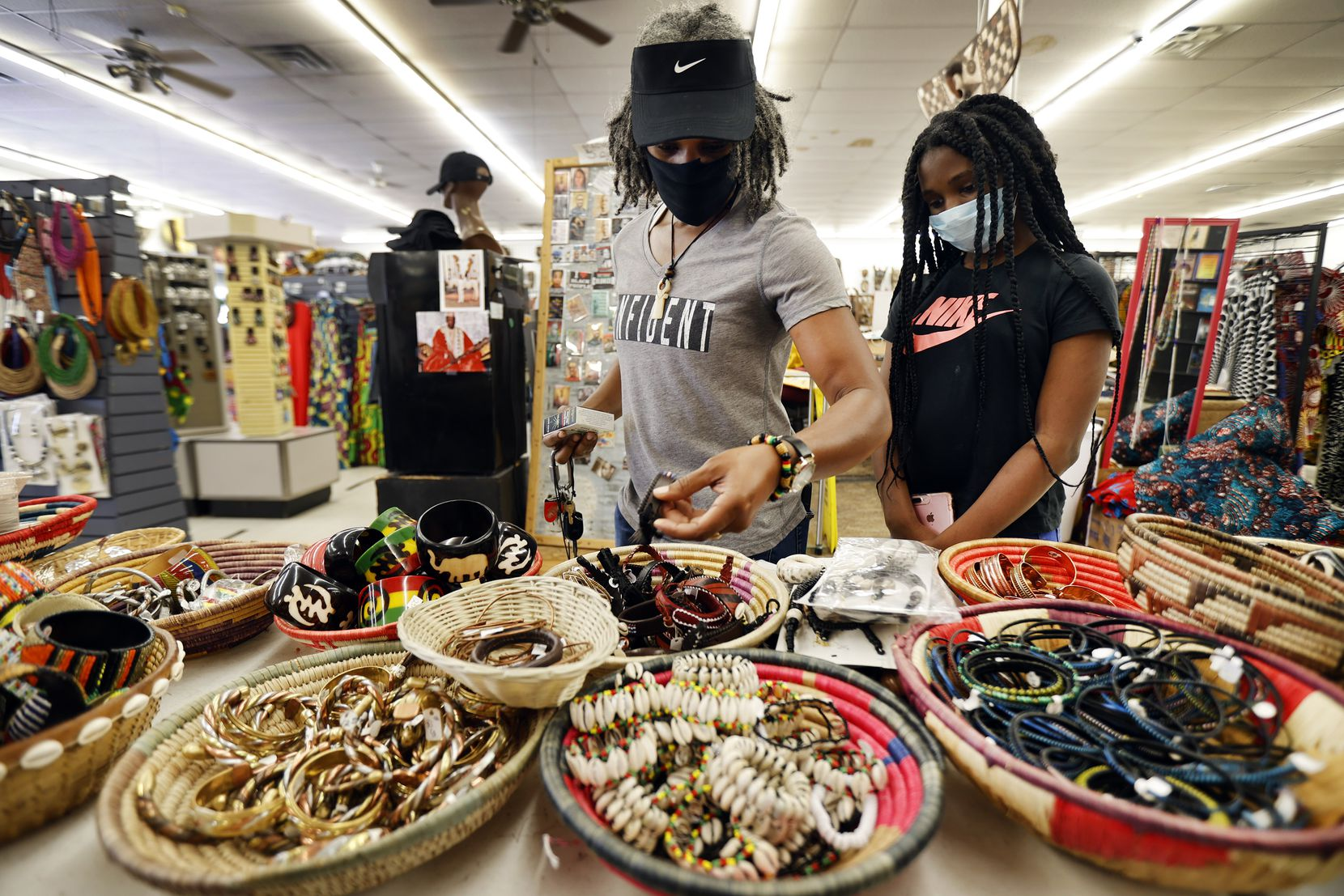 Charlene Turner and her niece Kamora, 12, of DeSoto, Texas shop at Pan-African Connection in Dallas, Thursday, July 2, 2020. (Tom Fox/The Dallas Morning News)