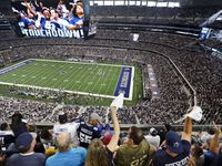 Fans are displayed on the giant overhead video screen as Dallas Cowboys fans cheer tight end Blake Jarwin's first quarter touchdown against the New York Giants at AT&T Stadium in Arlington, Texas, Sunday, September 8, 2019.