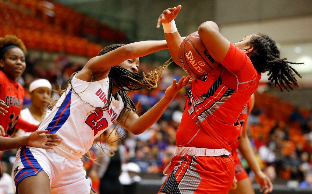 Duncanville's Anaya Bernard (20) tries to grab an offensive rebound from Cedar Hills' Portia Adams (11) during the first half of the Class 6A Region I championship game at Wilkerson-Greines Activity Center in Fort Worth, Saturday, February 29, 2020. (Tom Fox/The Dallas Morning News)